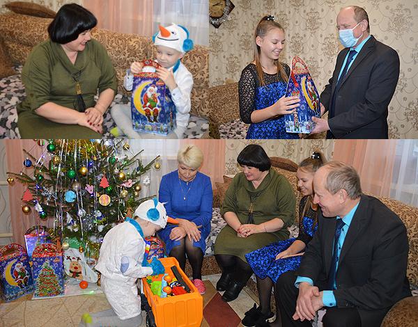 Приёмную семью Соболевских поздравили в Толочине председатель райисполкома Олег Лындин и его заместитель Инна Голубкова